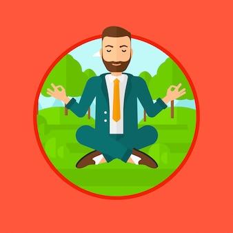 Uomo d'affari che medita nella posizione di loto.