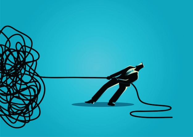 Uomo d'affari che prova a disfare corda o cavo aggrovigliata