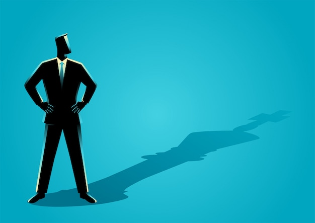 Uomo d'affari che sta con l'ombra di un re di scacchi