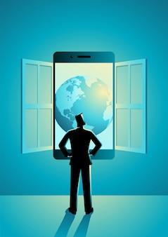Uomo d'affari che sta guardante attraverso la finestra fatta dello smart phone