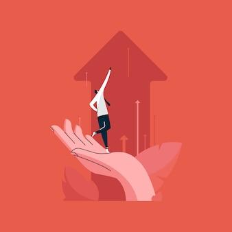 Uomo d'affari che sta sulla mano umana e che spinge le frecce del grafico di affari verso l'alto, concetto di crescita del gruppo di affari