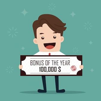 Uomo d'affari che tiene un assegno bancario per un bonus dell'anno.