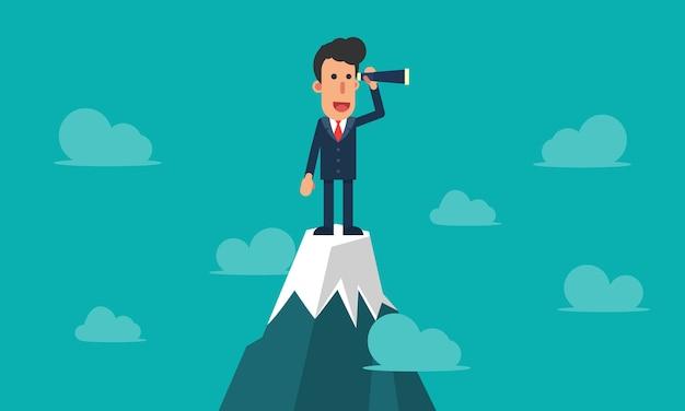 Uomo d'affari che utilizza telescopio che sta sopra la montagna