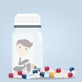 Uomo d'affari con bottiglie di pillola.