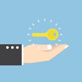 Uomo d'affari con chiave d'oro sopra la sua mano