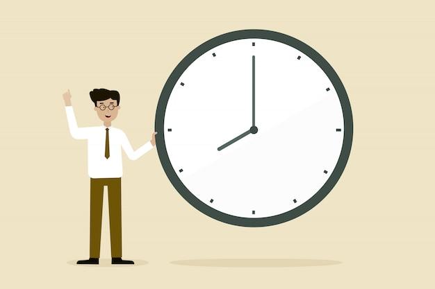 Uomo d'affari con grande orologio