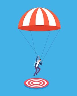 Uomo d'affari con il paracadute che punta su obiettivo.
