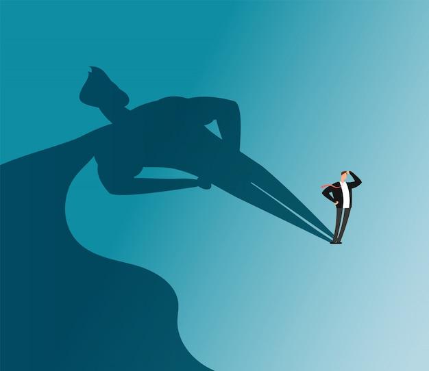 Uomo d'affari con l'ombra del supereroe. ambizione e concetto di vettore di successo di affari