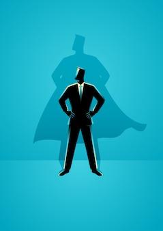 Uomo d'affari con l'ombra di supereroe
