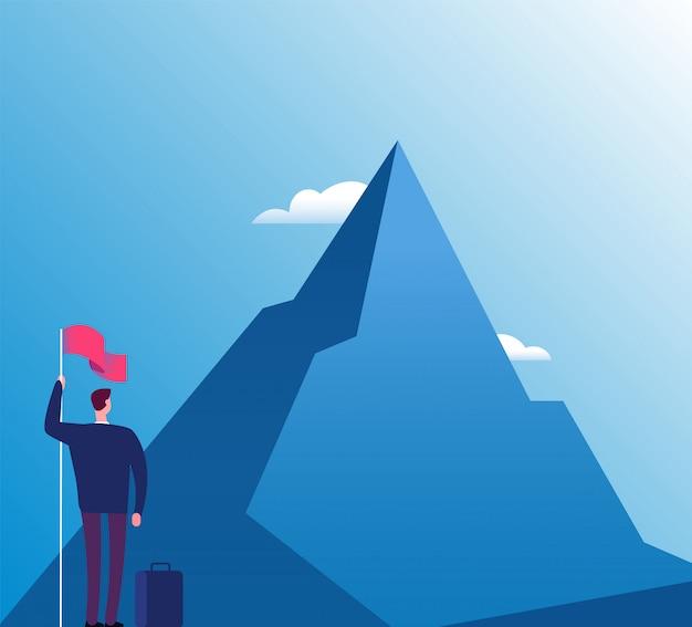 Uomo d'affari con la bandiera in montagna. nuovo scopo, visione di successo e raggiungimento degli obiettivi