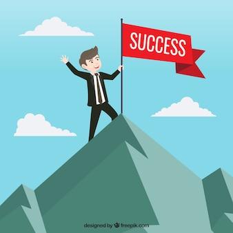 Uomo d'affari con la bandiera rossa del successo