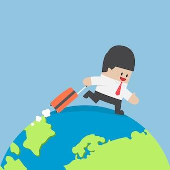 Uomo d'affari con la valigia in giro per il mondo
