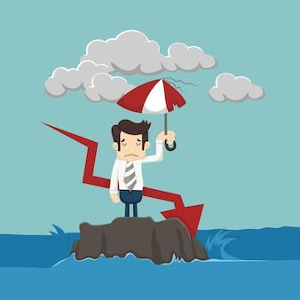 Uomo d'affari con ombrello in piedi nel mare