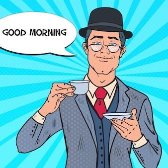 Uomo d'affari di pop art bere il tè la mattina