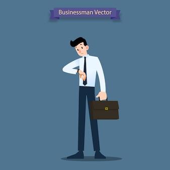 Uomo d'affari guarda il suo orologio.