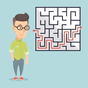 Uomo d'affari guardando il labirinto con soluzione.