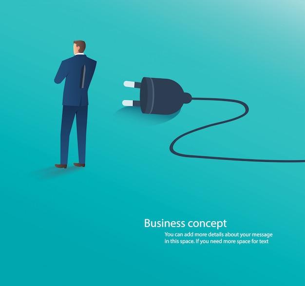 Uomo d'affari in piedi con la spina elettrica
