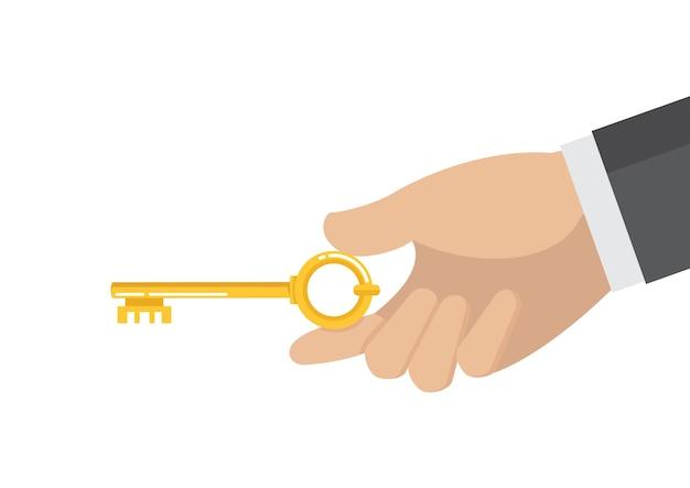 Uomo d'affari mano che tiene la chiave d'oro.