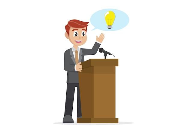 Uomo d'affari presenta la sua idea sul discorso del podio.