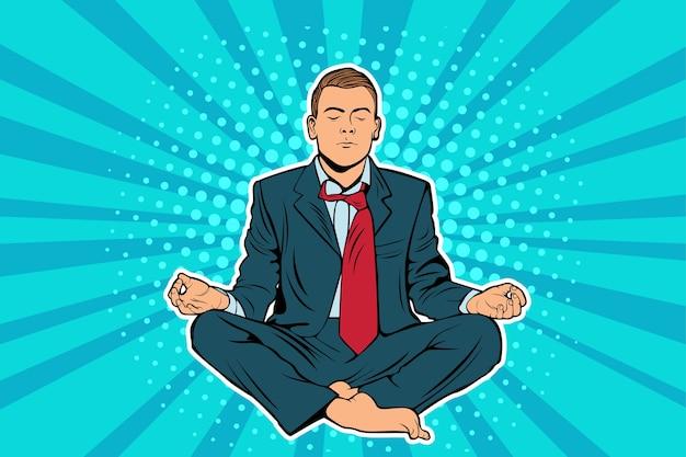 Uomo d'affari seduto nella posizione del loto