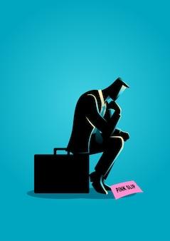 Uomo d'affari seduto sulla valigia