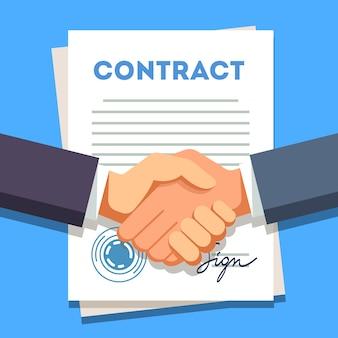 Uomo d'affari stringendo la mano su un contratto firmato