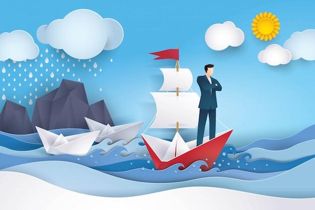 Uomo d'affari sulla barca a vela rossa e bianca nell'oceano