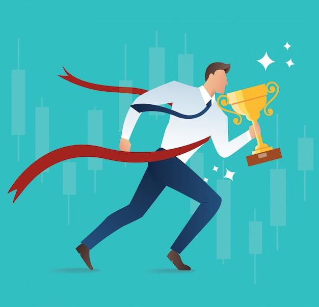 Uomo d'affari tenendo il concetto di trofeo per il successo
