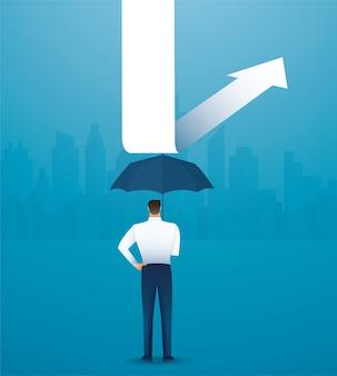 Uomo d'affari usa l'ombrello per proteggere la freccia verso il basso