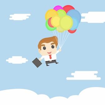 Uomo d'affari volare con palloncino