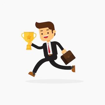 Uomo di affari che tiene una cartella e un trofeo