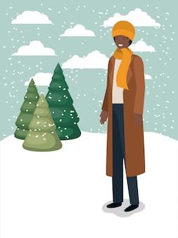 Uomo di colore in snowscape con abiti invernali