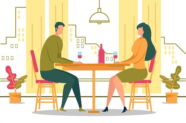 Uomo donna seduta al tavolo vicino alla finestra bere vino