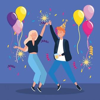 Uomo e donna che ballano con fuochi d'artificio di palloncini e stelle filanti