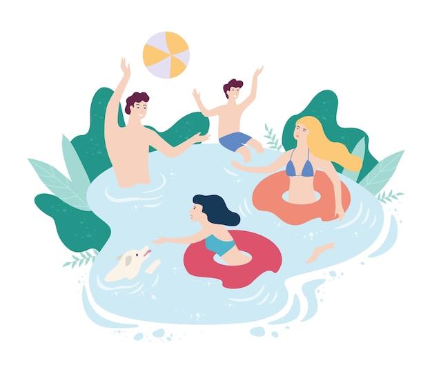 Uomo e donna che galleggia sul cerchio gonfiabile