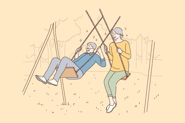 Uomo e donna che si distendono insieme nel parco
