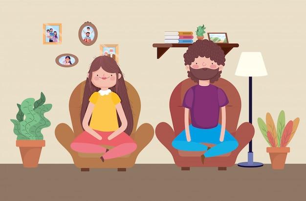 Uomo e donna che si siedono nella celebrazione felice di ringraziamento del sofà