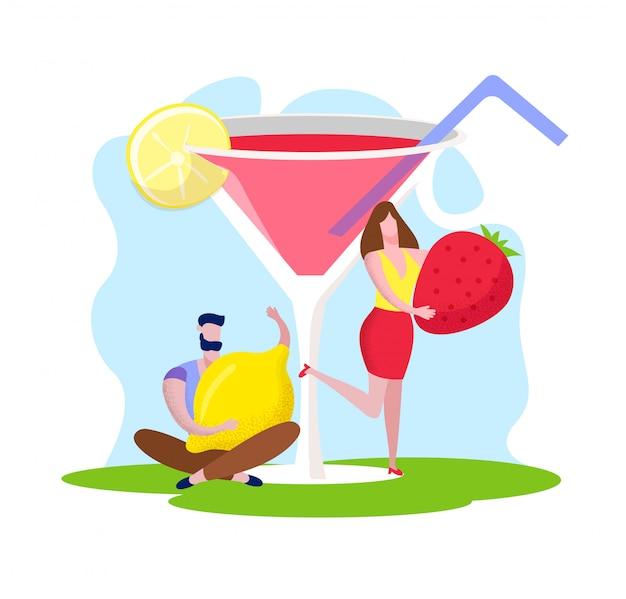 Uomo e donna che tengono fragola e limone enormi