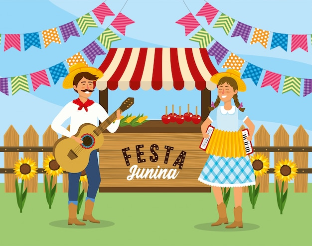 Uomo e donna con chitarra e fisarmonica con mercato