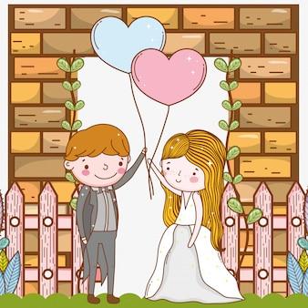 Uomo e donna con cuori palloncini e recinzione