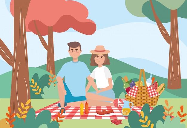 Uomo e donna nella tovaglia con bottiglia di vino e latte