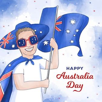 Uomo felice di giorno dell'australia con gli occhiali da sole che tengono bandiera