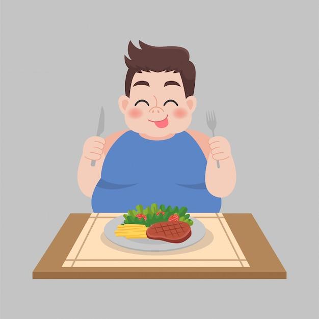 Uomo grasso pronto a mangiare cibi