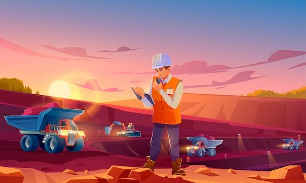 Uomo in casco che lavora alla cava di estrazione mineraria