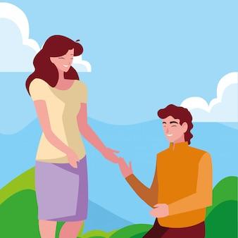 Uomo in ginocchio con la mano della holding della donna