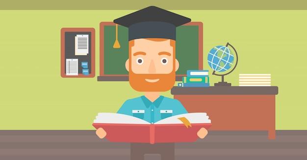 Uomo in libro di tenuta tappo di laurea.