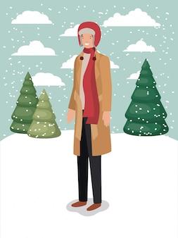 Uomo in snowscape con abiti invernali