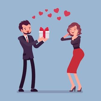 Uomo innamorato che dà regalo alla donna
