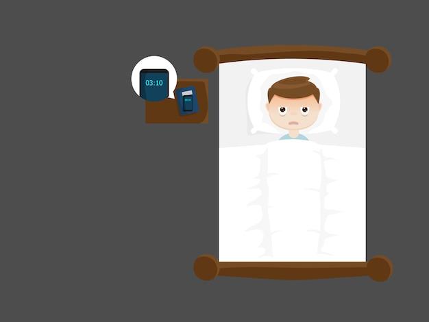 Uomo insonne sul letto di notte