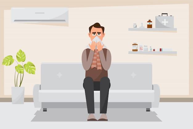 Uomo malato che ha un naso freddo e corrente in camera